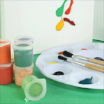 Pots of paint, pallette and brushes